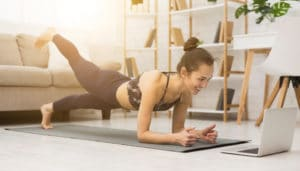 woman doing yoga workout in her living room